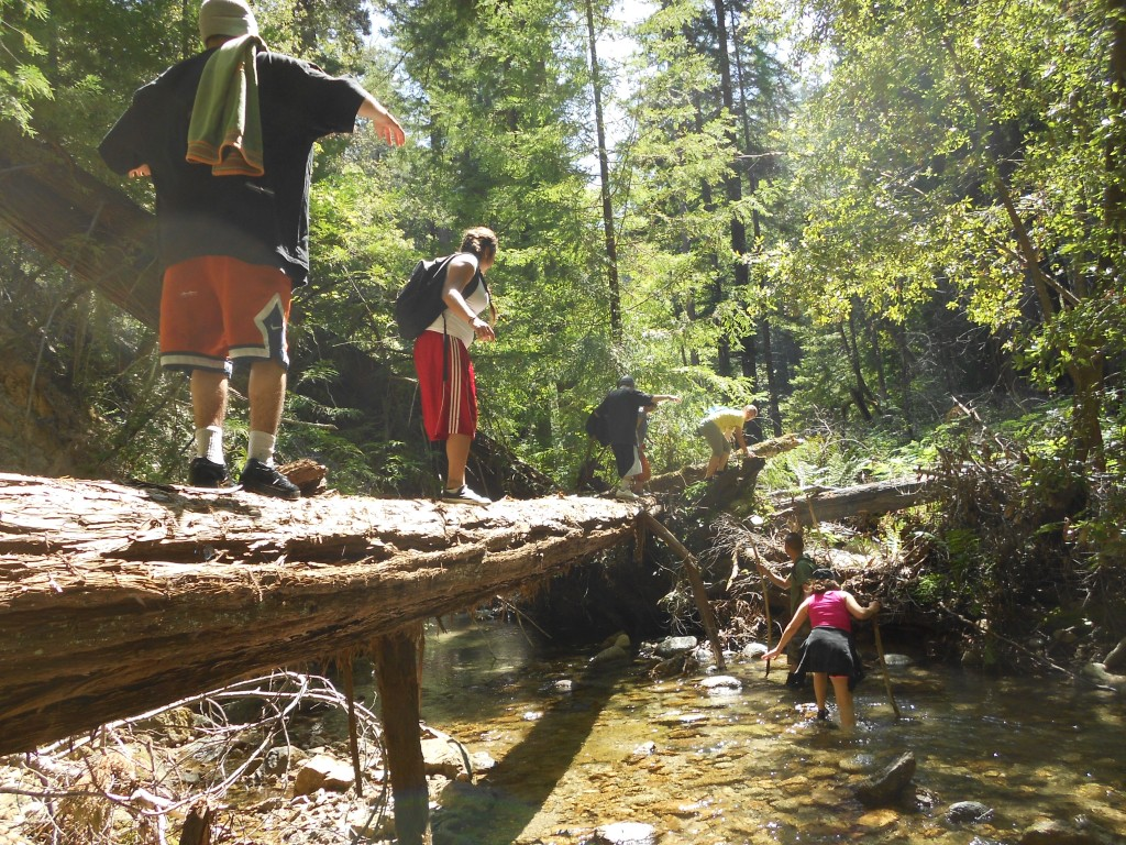 Students from Rancho Cielo cross the Little Sur River on a Youth in Wilderness outing
