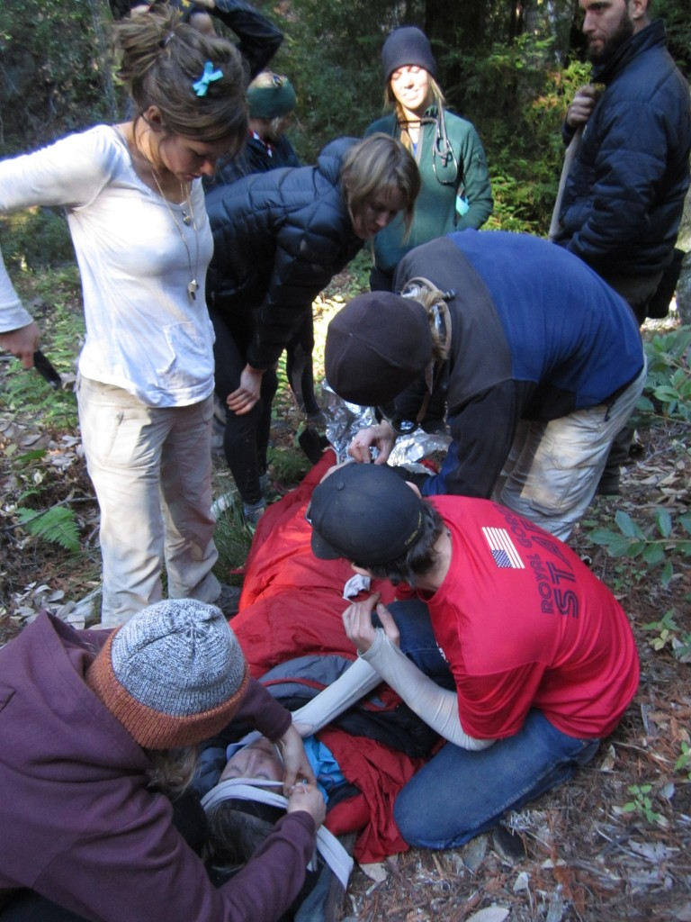 Students practice treatment of a suspected spine injury and evacuation