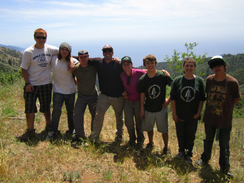 The group poses with the view before making the descent to Goat camp
