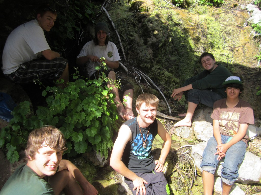 The boys relax by the spring at Goat camp