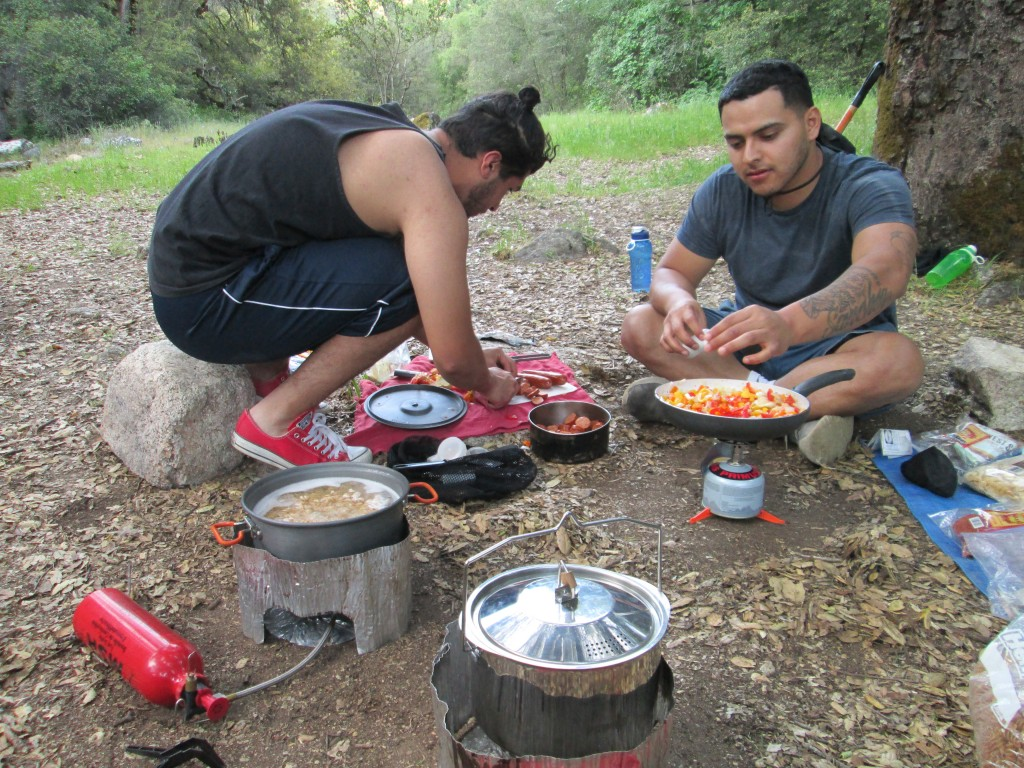 Culinary Academy students Issac and Jessie cooking up a backcountry meal for the group